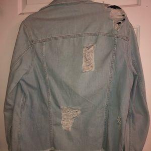 Ripped light wash jean jacket!
